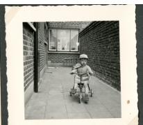 Marc Moerman op zijn driewieler, Merelbeke, 1961