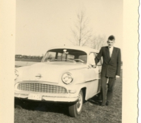 Gilbert De Paepe aan zijn Opel Record, Merelbeke, jaren 1960